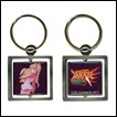 A metal keychain featuring a portrait of Amy from Burst Angel.